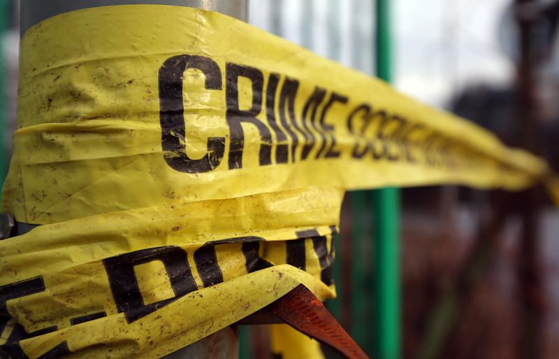 Stock image of police crime scene tape in Salford. (Photo by Dave Thompson/PA Images via Getty Images)