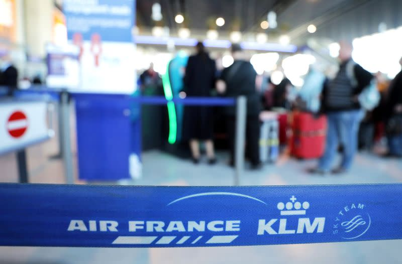 Passengers wait at the Air France desk at Nice international airport