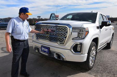 Local tractor dealership owner Mickey McMaster shows off his brand-new GMC Denali pickup truck in Decatur, Texas, U.S., February 4, 2019. REUTERS/Nick Carey