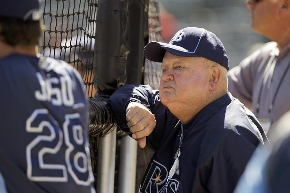 FILE - In this Sept. 30, 2011 file photo, former manager Don Zimmer watches the Tampa Bay Rays batting practice before Game 1 of baseball's American League division series playoffs against the Texas Rangers in Arlington, Texas. Don Zimmer, a popular fixture in professional baseball for 66 years as a manager, player, coach and executive, has died. He was 83. (AP Photo/Tony Gutierrez, File)