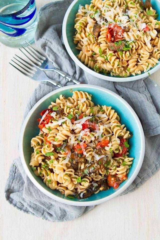 """<p>One serving of this flavorful, meatless <a rel=""""nofollow"""" href=""""https://www.cookincanuck.com/roasted-tomato-mushroom-pasta-recipe/"""">Roasted Tomato and Mushroom Pasta</a> is fewer than 300 calories! You will love this easy vegetarian option for pasta.</p>"""