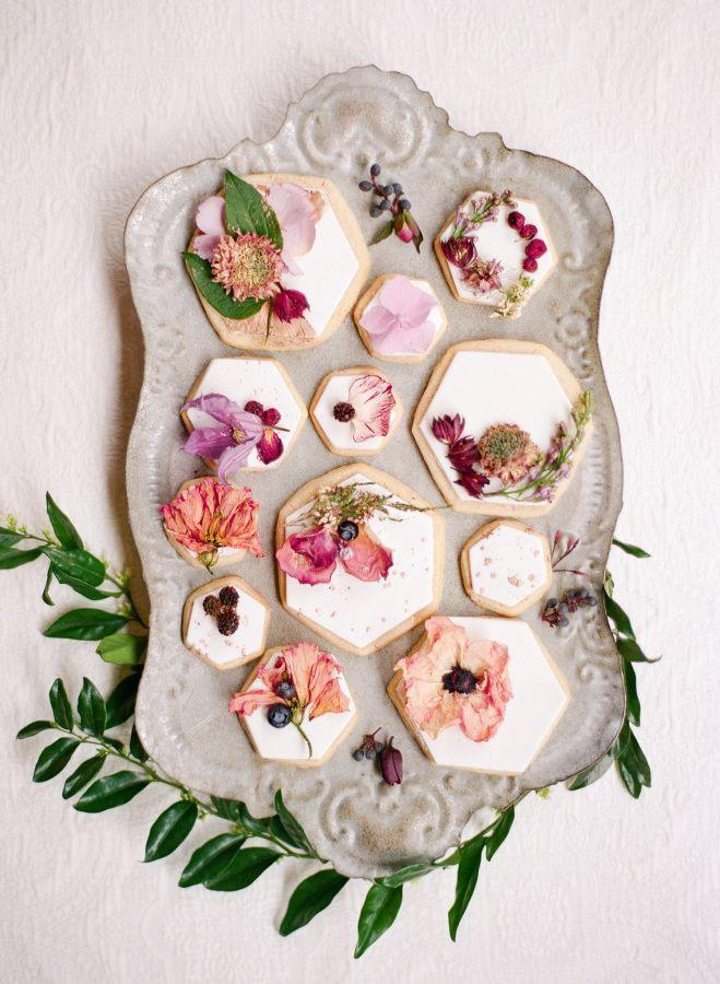 "<p>Dress up geometric cookies with white frosting and <a href=""https://www.elledecor.com/life-culture/food-drink/a8712/sugar-cookie-recipe/"" rel=""nofollow noopener"" target=""_blank"" data-ylk=""slk:edible flowers"" class=""link rapid-noclick-resp"">edible flowers</a> for a show-stopping treat bound to give your hon butterflies. Besides—why give flowers for a vase when you can give flowers to eat? </p><p><em>Via <a href=""http://www.stylemepretty.com/vault/image/4956600"" rel=""nofollow noopener"" target=""_blank"" data-ylk=""slk:Style Me Pretty Living"" class=""link rapid-noclick-resp"">Style Me Pretty Living</a></em><br></p><p><a class=""link rapid-noclick-resp"" href=""https://go.redirectingat.com?id=74968X1596630&url=https%3A%2F%2Fwww.shopterrain.com%2Fproducts%2Frose-petals&sref=https%3A%2F%2Fwww.elledecor.com%2Flife-culture%2Ffun-at-home%2Fg2387%2Fvalentines-day-decor%2F"" rel=""nofollow noopener"" target=""_blank"" data-ylk=""slk:GET THE LOOK"">GET THE LOOK</a><em><br>Edible Rose Petals, Terrain, $10</em></p>"