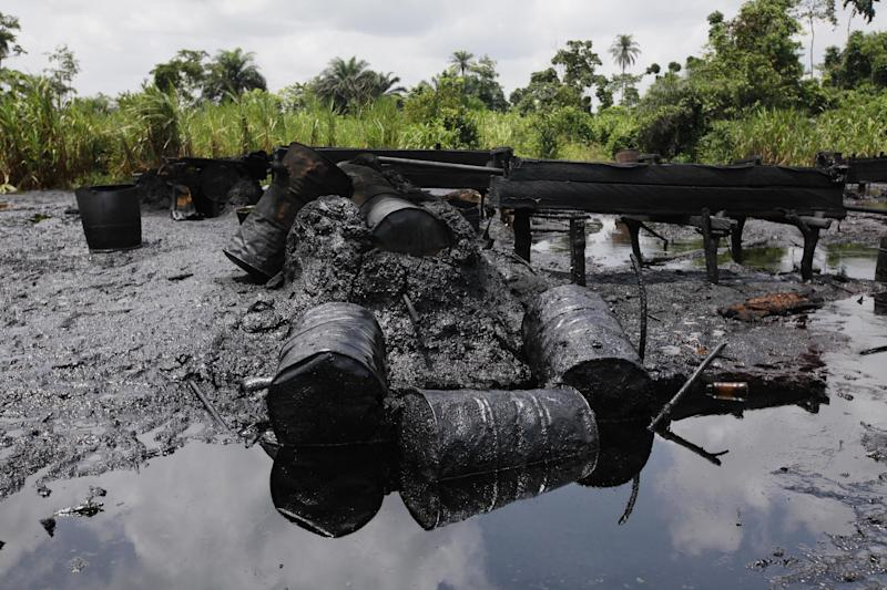 In this photo taken Saturday, May 18, 2013, an abandoned illegal refinery is seen at the creeks of Bayelsa, Nigeria. The first drops of crude float in the languid muddy currents of Nigeria's oil-rich southern delta, then slowly grow into the splatter of massive crime scene. Oil thefts, long a problem in the Niger Delta, are growing at an ever-faster rate despite government officials and international companies offering increasingly dire warnings about the effect on Nigeria's crude production. Some 200,000 barrels a day representing about 10 percent of Nigeria's production are siphoned off pipelines crisscrossing the region. (AP Photo/Sunday Alamba)