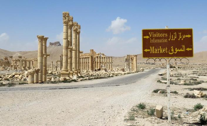 A tourist sign at the ancient city of Palmyra, after government troops recaptured the UNESCO world heritage site from the Islamic State group (AFP Photo/)