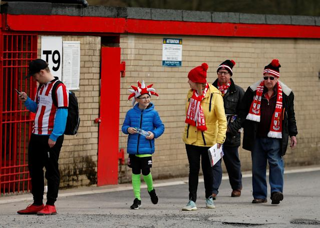 "Soccer Football - League Two - Accrington Stanley v Lincoln City - Wham Stadium, Accrington, Britain - April 28, 2018 Lincoln City fans outside the stadium Action Images/Andrew Boyers EDITORIAL USE ONLY. No use with unauthorized audio, video, data, fixture lists, club/league logos or ""live"" services. Online in-match use limited to 75 images, no video emulation. No use in betting, games or single club/league/player publications. Please contact your account representative for further details."