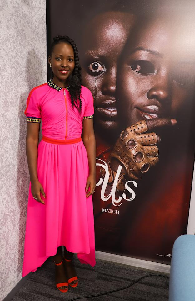 <p>On March 21, Lupita Nyong'o further cemented her position as our new go-to style muse in hot pink Schiaparelli. <em>[Photo: Getty]</em> </p>
