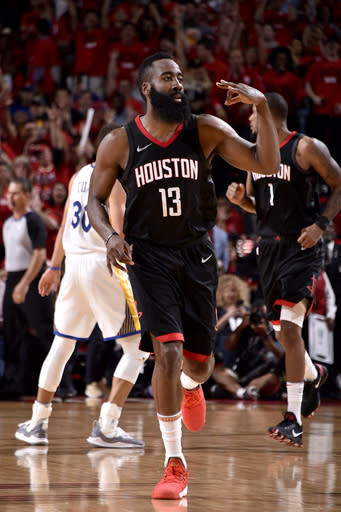 HOUSTON, TX - MAY 16: James Harden #13 of the Houston Rockets celebrates hitting a three point shot against the Golden State Warriors in Game Two of the Western Conference Finals of the 2018 NBA Playoffs on May 16, 2018 at the Toyota Center in Houston, Texas. (Photo by Bill Baptist/NBAE via Getty Images)