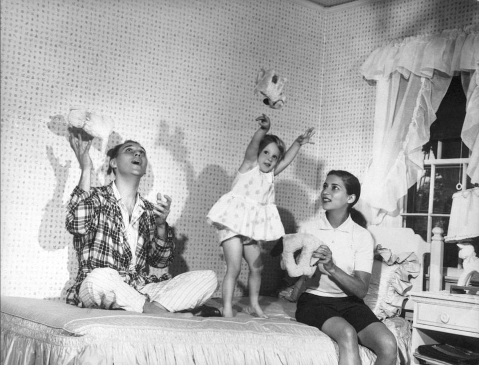 The Ginsburgs play with their 3-year old daughter, Jane, in her bedroom at Martin's parents' home in Rockville Centre, N.Y. (Photo: Supreme Court of the United States)