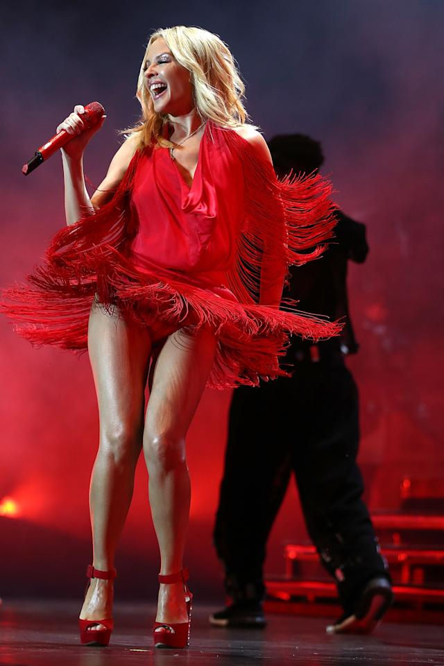 <p>The Aussie blonde performed on stage during day one of the Singapore Formula One Grand Prix at Marina Bay Street Circuit on September 16, 2016 in Singapore. Source: Getty </p>