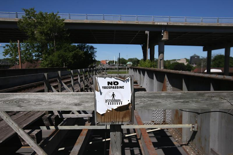 A sign urges pedestrians not to walk over a rail bridge connecting the US with Canada on June 4, 2013