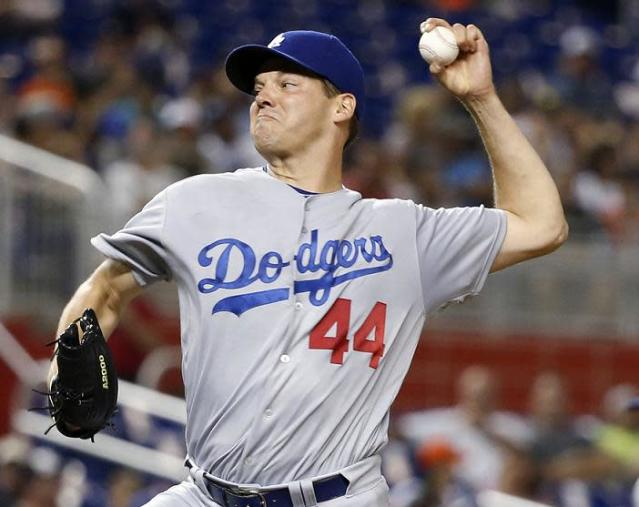 Rich Hill was pulled Saturday seven innings into a perfect game bid against the Marlins. (AP)