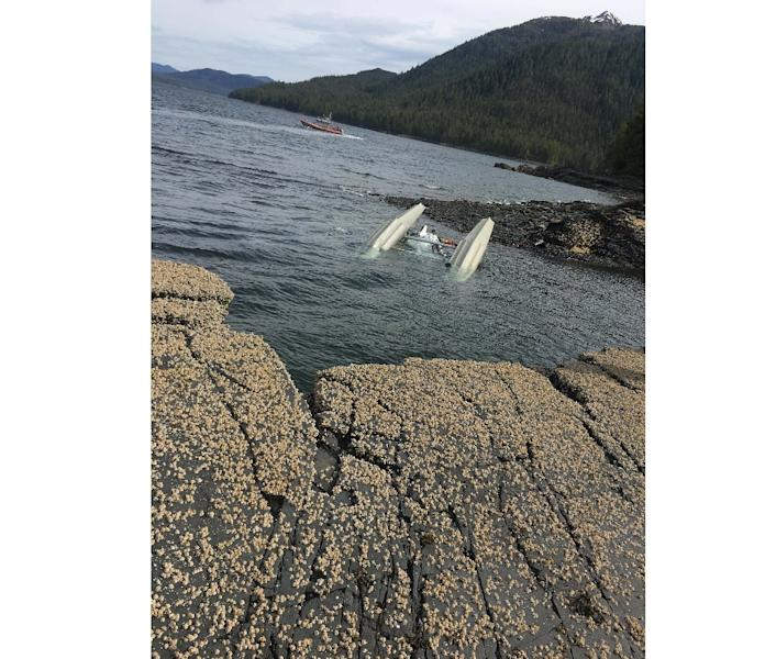 In this image released by the US Coast Guard (USCG), a floatplane lies upside down after a mid-air collision with another plane on May 13, 2019, in Ketchikan, Alaska -- six people were killed in the incident (AFP Photo/RYAN SINKEY)