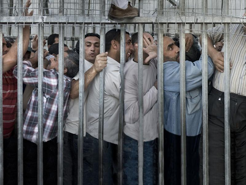 "Every day, before sunset, thousands of Palestinian workers spend between two and four hours clumped together to cross the so-called ""CheckPoint 300,"" which divides Bethlehem and Jerusalem, in order to go working in Jerusalem and surrounding areas."