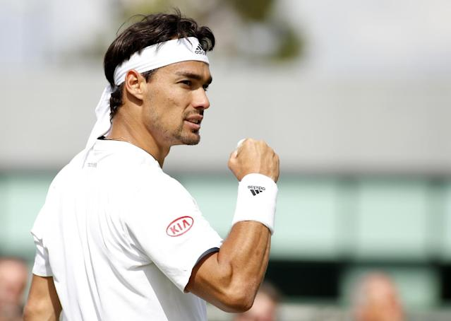 Fabio Fognini of Italy celebrates winning a game against Tim Puetz of Germany during their match at the All England Lawn Tennis Championships in Wimbledon, London, Wednesday, June 25, 2014. (AP Photo/Alastair Grant)