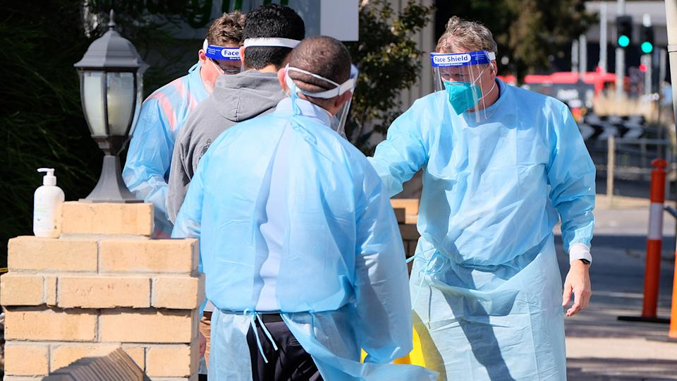 Quarantining hotel guests at the Holiday Inn near Melbourne Airport, pictured here being moved to a new location.