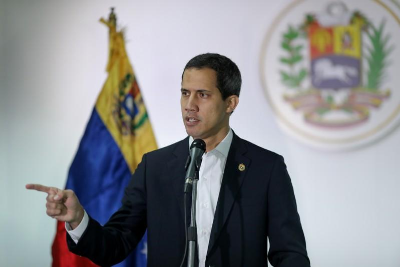 FILE PHOTO: Venezuelan opposition leader Juan Guaido, who many nations have recognised as the country's rightful interim ruler, speaks during a news conference in Caracas