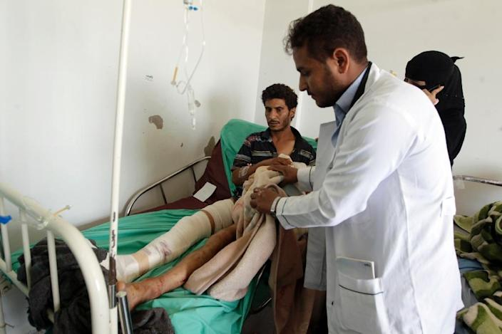 A Yemeni man receives treatment at a hospital in the capital Sanaa on April 21, a day after he was wounded in a Saudi-led airstrike (AFP Photo/Mohammed Huwais)