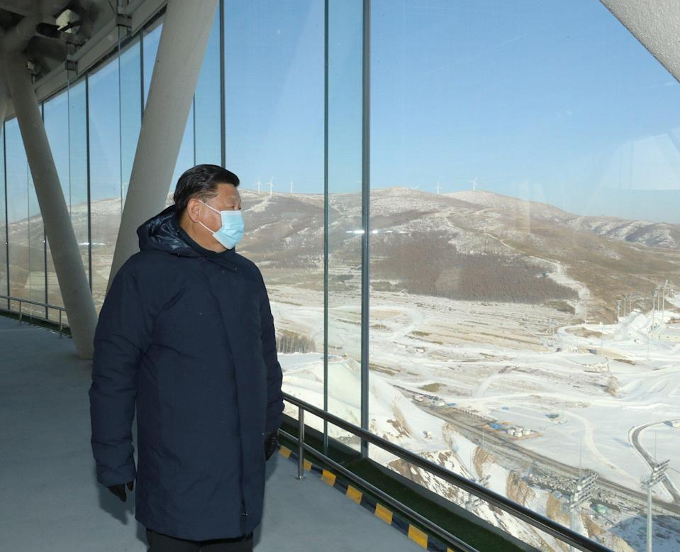 President Xi Jinping, seen in an Anta-made parka during an inspection of the National Ski Jumping Center in Hebei province in January. The stock jumped on the report. Photo: Xinhua.