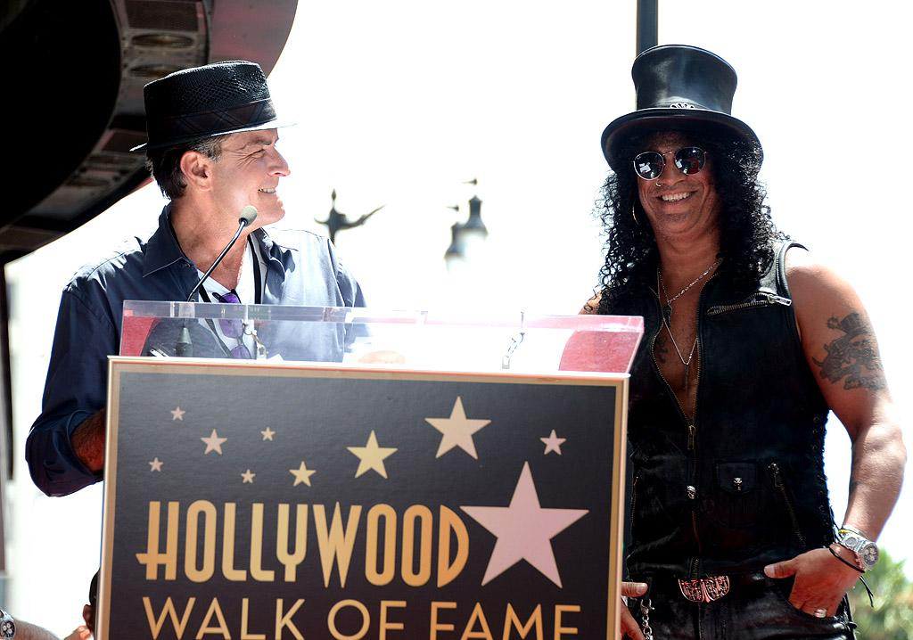 "Never one to miss out on a media opportunity (good <i>or</i> bad), Charlie Sheen attended the Hollywood Walk of Fame ceremony on Tuesday honoring ""Guns N Roses"" guitarist Slash, who received the fabled walk's 2,473rd star. ""You know, it's quite fitting, I think, that Slash is getting a star  on the very street that Axl Rose will one day be sleeping on,"" Sheen said during his speech honoring Slash. Ouch! (7/10/2012)"