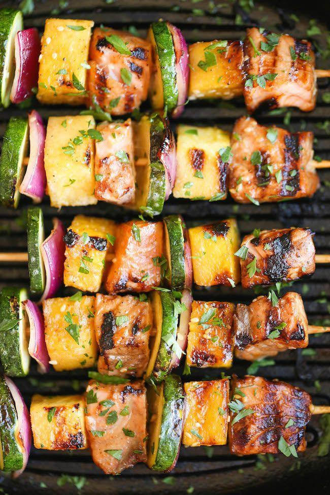 """<p>These beauties would make a great addition to any cookout spread. The salmon chunks are marinated in a flavorful soy sauce mixture, then threaded with pineapple, red onion, and zucchini. Throw the skewers on the grill and they'll be ready in just 5 to 7 minutes. (And if you don't have a grill, you can use a grill pan.)</p><p><strong>Get the recipe at <a href=""""https://damndelicious.net/2015/05/11/asian-salmon-kabobs/"""" rel=""""nofollow noopener"""" target=""""_blank"""" data-ylk=""""slk:Damn Delicious"""" class=""""link rapid-noclick-resp"""">Damn Delicious</a>.</strong></p><p><a class=""""link rapid-noclick-resp"""" href=""""https://go.redirectingat.com?id=74968X1596630&url=https%3A%2F%2Fwww.walmart.com%2Fbrowse%2Fhome%2Fgriddles-grill-pans%2F4044_623679_8140341_6082871&sref=https%3A%2F%2Fwww.thepioneerwoman.com%2Ffood-cooking%2Fmeals-menus%2Fg37023193%2Fsalmon-recipes%2F"""" rel=""""nofollow noopener"""" target=""""_blank"""" data-ylk=""""slk:SHOP GRILL PANS"""">SHOP GRILL PANS</a></p>"""