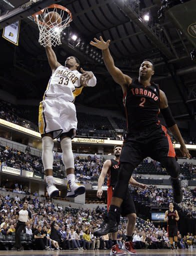 Indiana Pacers forward Danny Granger, left, dunks next to Toronto Raptors forward James Johnson (2) in the second half of an NBA basketball game in Indianapolis, Monday, April 9, 2012. The Pacers defeated the Raptors 103-98. (AP Photo/Michael Conroy)