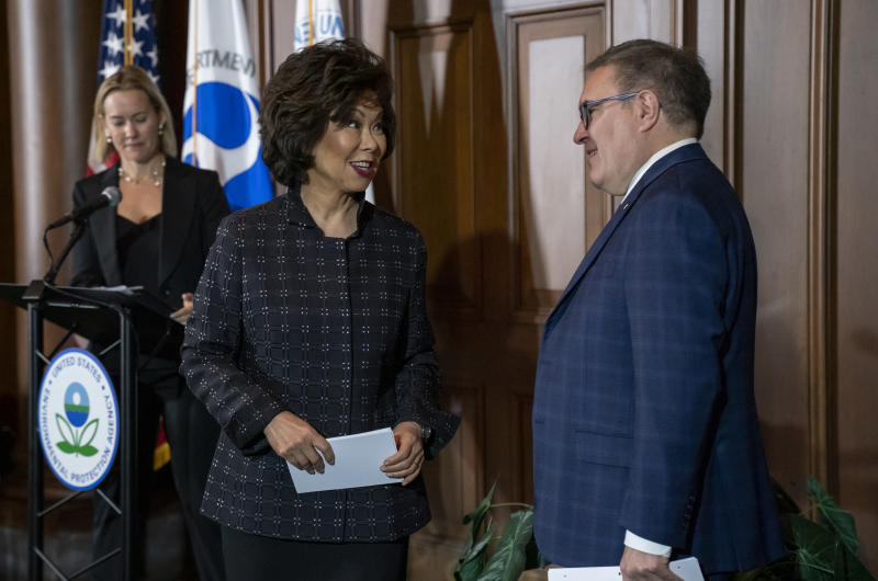Environmental Protection Agency administrator Andrew Wheeler, right, and Transportation Secretary Elaine Chao speak to reporters about President Donald Trump's decision to revoke California's authority to set auto mileage standards stricter than those issued by federal regulators, at EPA headquarters in Washington, Wednesday, Sept. 18, 2019.  (AP Photo/J. Scott Applewhite)