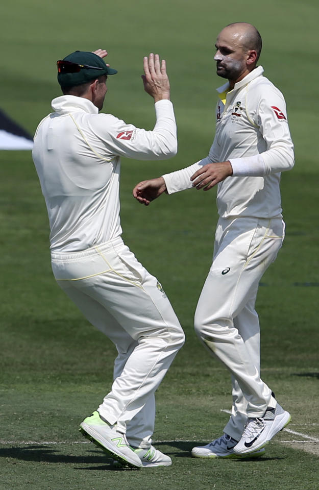 Australia's Nathan Lyon, right, celebrates the dismissal of Pakistan's Azhar Ali with a teammate during their test match in Abu Dhabi, United Arab Emirates, Tuesday, Oct. 16, 2018. (AP Photo/Kamran Jebreili)
