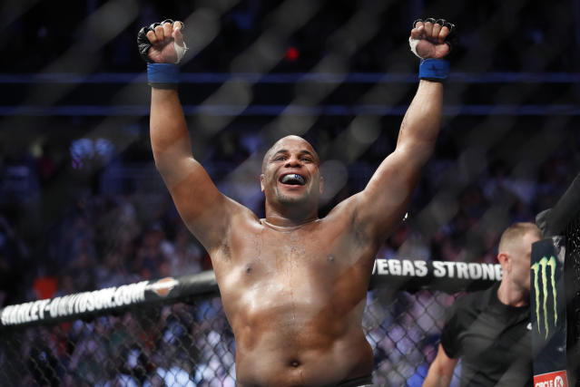 Daniel Cormier celebrates after defeating Stipe Miocic in a heavyweight title mixed martial arts bout at UFC 226, Saturday, July 7, 2018, in Las Vegas. (AP Photo/John Locher)