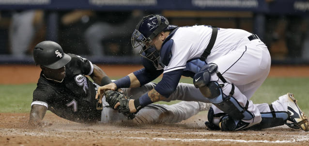 Tampa Bay Rays catcher Jesus Sucre, right, tags out Chicago White Sox's Tim Anderson during the 10th inning of a baseball game Friday, Aug. 3, 2018, in St. Petersburg, Fla. (AP Photo/Chris O'Meara)