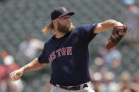 Boston Red Sox starting pitcher Andrew Cashner delivers to a Baltimore Orioles batter during the first inning of a baseball game, Sunday, July 21, 2019, in Baltimore. (AP Photo/Julio Cortez)