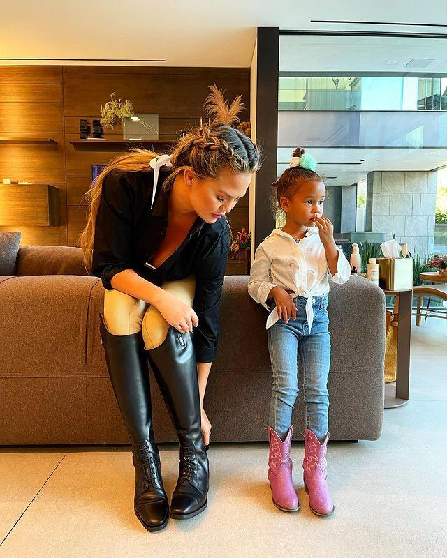 """<p>Chrissy Teigen and John Legend's daughter Luna is looking more and more like her famous model mother every day.</p><p>In a cute mother-daughter photo posted to Instagram on January 17, Teigen revealed that the day marked the four year old's first time wearing jeans (which also involved an 'epic jean meltdown').</p><p>In the snap, Teigen can be seen wearing cream-coloured riding jodhpurs and black riding boots, while her daughter sports a pair of pink cowboy boots, jeans and a white shirt. The pair looked adorable in their 'twinning' equestrian looks.<br></p><p>The model and mother-of-two opened up about her decision to take up horse-riding on Twitter, noting that it was suggestion from her therapist. </p><p>'My therapist says I need something that I do for just me, as I have absolutely nothing currently lol,' she <a href=""""https://twitter.com/chrissyteigen/status/1350466325353623554"""" rel=""""nofollow noopener"""" target=""""_blank"""" data-ylk=""""slk:tweeted"""" class=""""link rapid-noclick-resp"""">tweeted</a>. 'Today begins my journey into the horse world. I hope this dude likes me. He's so handsome and appears lazy, I love.' she wrote alongside a snap uploaded to the social media website of herself at the stables.'</p><p><a href=""""https://www.instagram.com/p/CKJ1ZskB9mj/?igshid=e7h3ckqrv819"""" rel=""""nofollow noopener"""" target=""""_blank"""" data-ylk=""""slk:See the original post on Instagram"""" class=""""link rapid-noclick-resp"""">See the original post on Instagram</a></p>"""