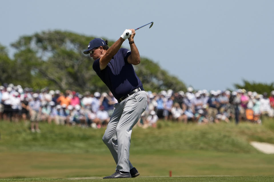 Phil Mickelson makes his second shot on the second hole during the final round at the PGA Championship golf tournament on the Ocean Course, Sunday, May 23, 2021, in Kiawah Island, S.C. (AP Photo/David J. Phillip)