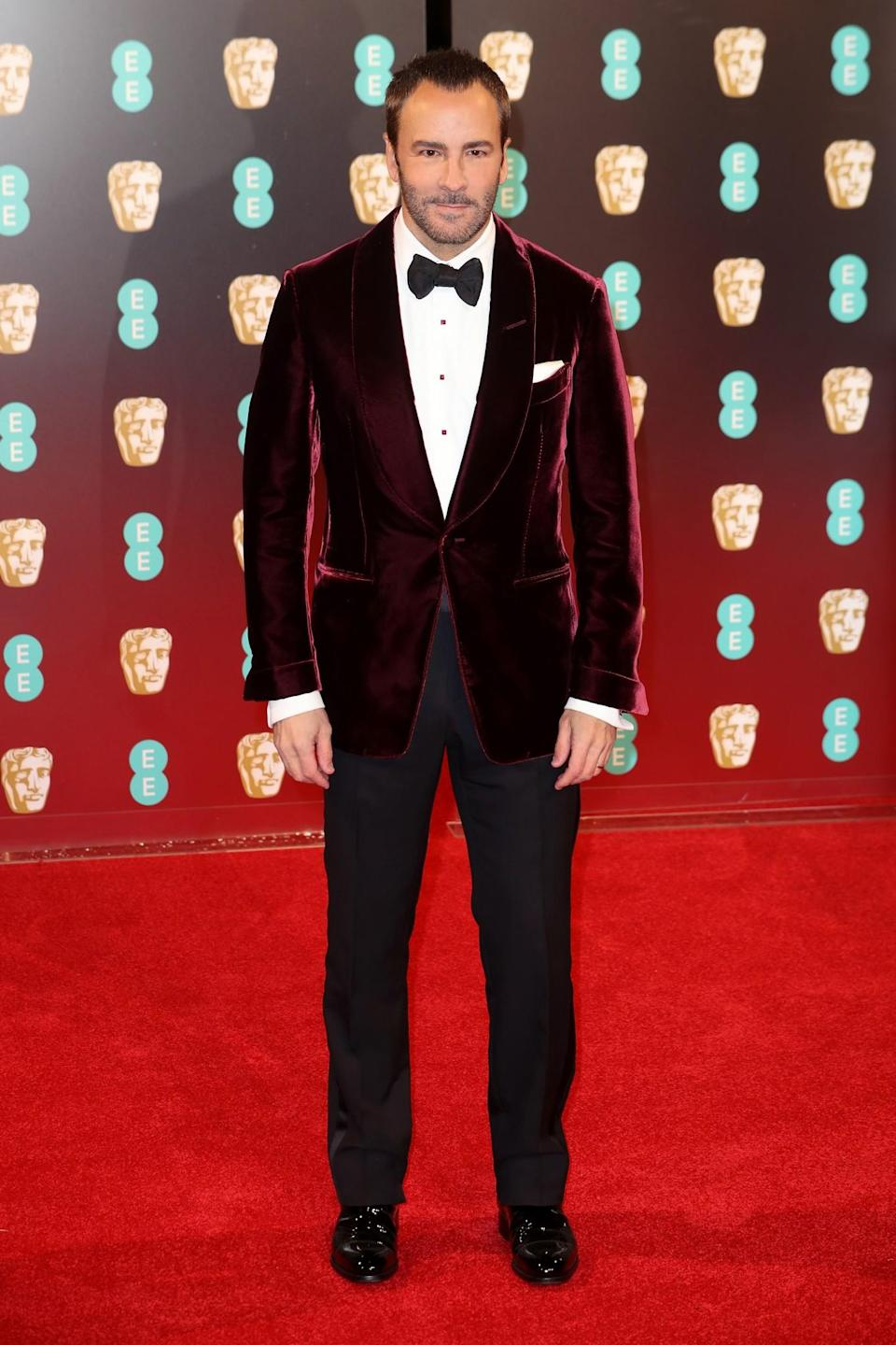 <p>As always, Tom Ford was impeccably dressed in a burgundy velvet tex. <i>[Photo: Getty]</i> </p>