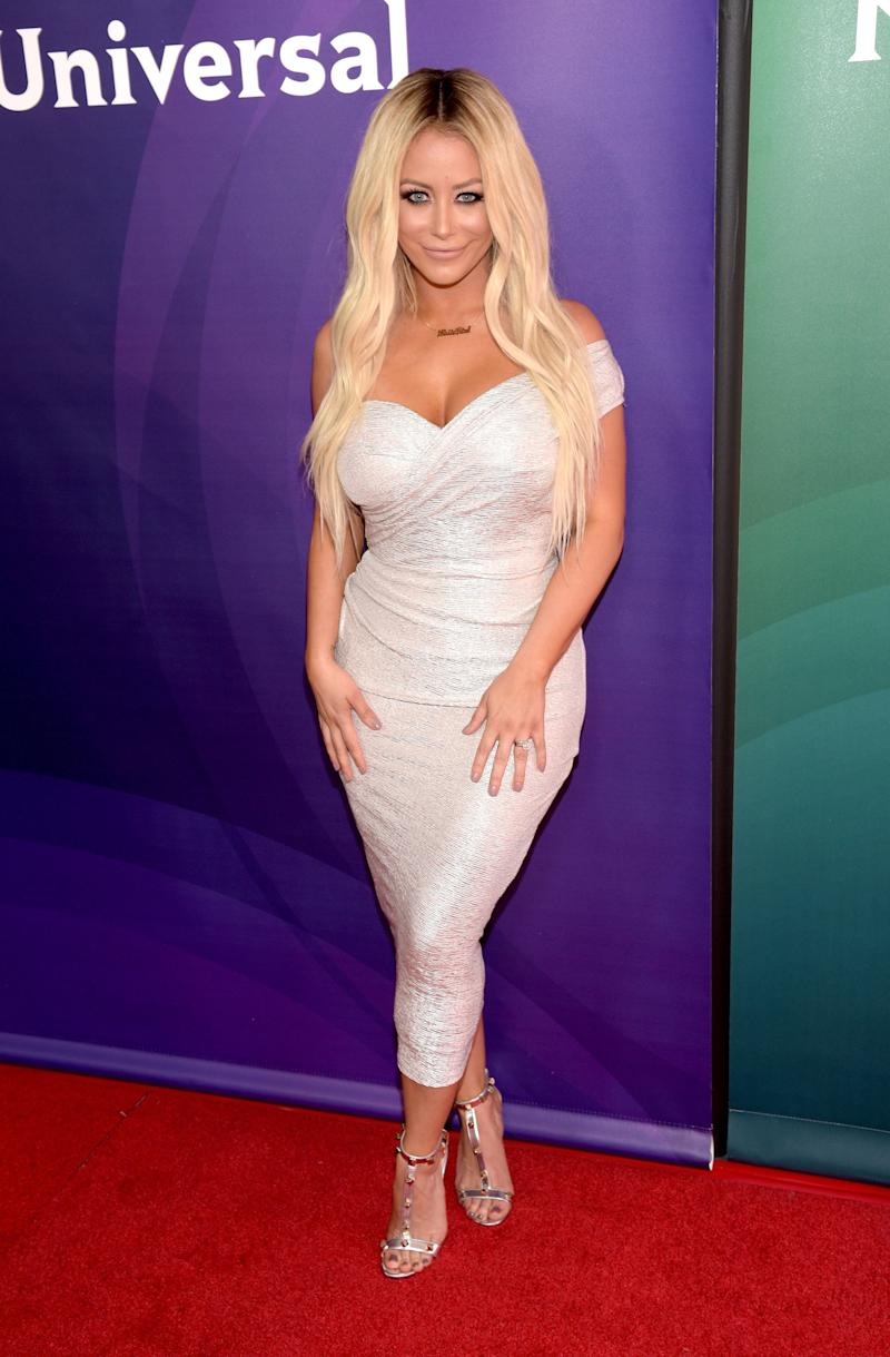 Aubrey O'Day poses at an event