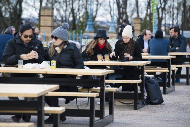 Customers enjoy a drink at the reopening of the Terrace Bar at Alexandra Palace, London (Kirsty O'Connor/PA)