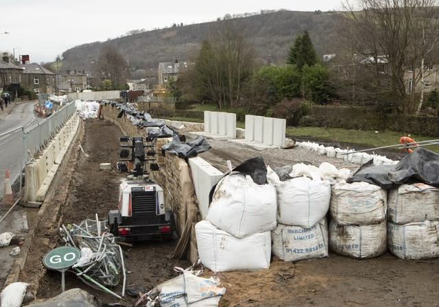 Flood defences in Mytholmroyd in the Upper Calder Valley in West Yorkshire ahead of Storm Dennis