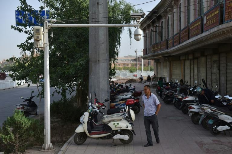 Local residents in Xinjiang are tightly monitored by an array of high-tech surveillance systems (AFP Photo/GREG BAKER)
