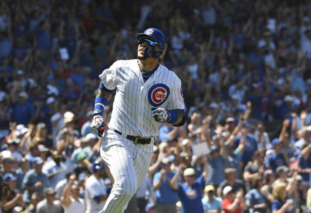 Chicago Cubs' Javier Baez (9) runs the bases after hitting a two-run home run against the Milwaukee Brewers during the third inning of a baseball game, Friday, Aug. 2, 2019, in Chicago. (AP Photo/David Banks)