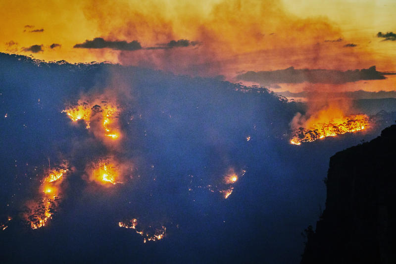 Fires in Jamison Valley, Katoomba, Blue Mountains, Australia. Climate change is causing extreme weather, prolonged droughts and increasing bushfires