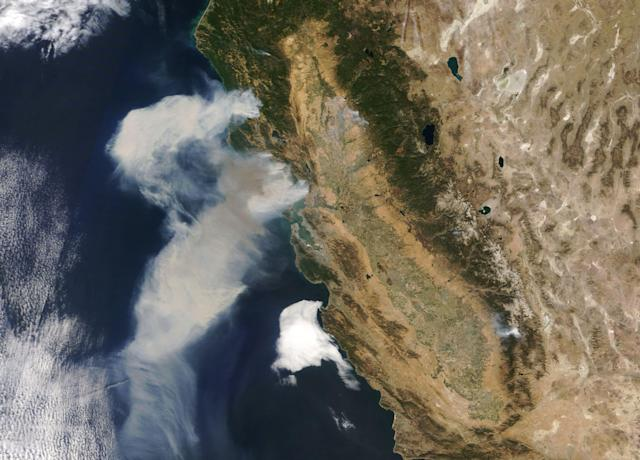 <p>The Moderate Resolution Imaging Spectroradiometer (MODIS) on NASA's Terra satellite acquired a natural-color image of the smoke billowing from wildfires in northern California on Oct. 9, 2017. Parts of Northern California have been ravaged by intense and fast-burning wildfires that broke out on Oct. 8, 2017. Blazes that started on a few hundred acres around Napa Valley were fanned by strong northeasterly winds, and by Oct. 10, the 14 fires had consumed as much as 100,000 acres (150 square miles) of land. States of emergency have been declared in Napa, Sonoma, Yuba, and Mendocino counties, and thousands of people were asked to evacuate. (Photo: Joshua Stevens, using MODIS data from LANCE/EOSDIS Rapid Response/NASA) </p>