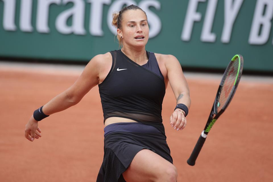 Aryna Sabalenka (pictured) kicks out at her tennis racquet after throwing it to the floor during her loss against Anastasia Pavlyuchenkova.