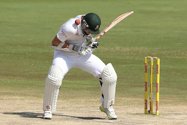 CENTURION, SOUTH AFRICA - FEBRUARY 15: Ryan McLaren of South Africa is hit by a delivery from Mitchell Johnson of Australia during day four of the First Test match between South Africa and Australia on February 15, 2014 in Centurion, South Africa. (Photo by Morne de Klerk/Getty Images)