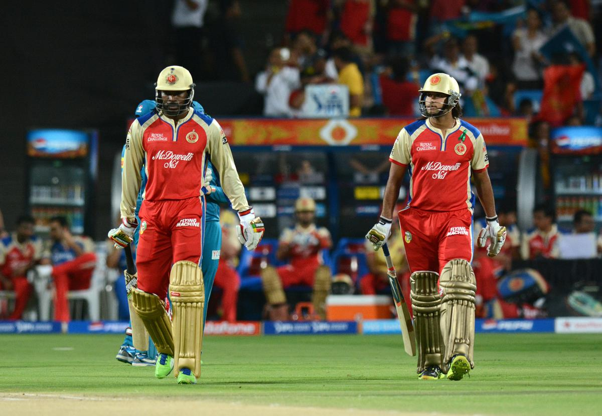 Chris Gayle of Royal Challengers Bangalore and Saurabh Tiwary of Royal Challengers Bangalore walk into bat during match 46 of the Pepsi Indian Premier League ( IPL) 2013  between The Pune Warriors India and the Royal Challengers Bangalore held at the Subrata Roy Sahara Stadium, Pune on the 2nd May 2013..Photo by Pal Pillai-IPL-SPORTZPICS   ..Use of this image is subject to the terms and conditions as outlined by the BCCI. These terms can be found by following this link:..https://ec.yimg.com/ec?url=http%3a%2f%2fwww.sportzpics.co.za%2fimage%2fI0000SoRagM2cIEc&t=1493537231&sig=qChMdyPkNZS45YpQ51LISQ--~C