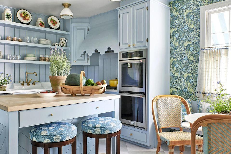 "<p>Refined powder-blue cabinets and a sinuous floral wallcovering by <a href=""https://www.finestwallpaper.com/store/c65/Morris_%26_Co.html"" rel=""nofollow noopener"" target=""_blank"" data-ylk=""slk:William Morris"" class=""link rapid-noclick-resp"">William Morris</a> enliven the quaint kitchen in this <a href=""https://www.veranda.com/decorating-ideas/a26603488/mark-d-sikes-works-midcentury-magic-on-a-southern-ranch-house/"" rel=""nofollow noopener"" target=""_blank"" data-ylk=""slk:Southern 1950s ranch"" class=""link rapid-noclick-resp"">Southern 1950s ranch</a>. Designer <a href=""https://markdsikes.com/"" rel=""nofollow noopener"" target=""_blank"" data-ylk=""slk:Mark D. Sikes"" class=""link rapid-noclick-resp"">Mark D. Sikes</a> covered the pair of stools by <a href=""http://www.hickorychair.com/"" rel=""nofollow noopener"" target=""_blank"" data-ylk=""slk:Hickory Chair"" class=""link rapid-noclick-resp"">Hickory Chair</a> in a botanic <a href=""http://www.carolinairvingtextiles.com/"" rel=""nofollow noopener"" target=""_blank"" data-ylk=""slk:Carolina Irving"" class=""link rapid-noclick-resp"">Carolina Irving</a> fabric. The bistro chairs are from <a href=""https://www.ballarddesigns.com/"" rel=""nofollow noopener"" target=""_blank"" data-ylk=""slk:Ballard Designs"" class=""link rapid-noclick-resp"">Ballard Designs</a>. The kitchen paint color is Farrow & Ball's Parma Gray. <br><br><a class=""link rapid-noclick-resp"" href=""https://go.redirectingat.com?id=74968X1596630&url=https%3A%2F%2Fwww.farrow-ball.com%2Fen-us%2Fpaint-colours%2Fparma-gray&sref=https%3A%2F%2Fwww.veranda.com%2Fdecorating-ideas%2Fcolor-ideas%2Fg28700927%2Fkitchen-paint-colors%2F"" rel=""nofollow noopener"" target=""_blank"" data-ylk=""slk:Get the Look"">Get the Look</a><br></p>"