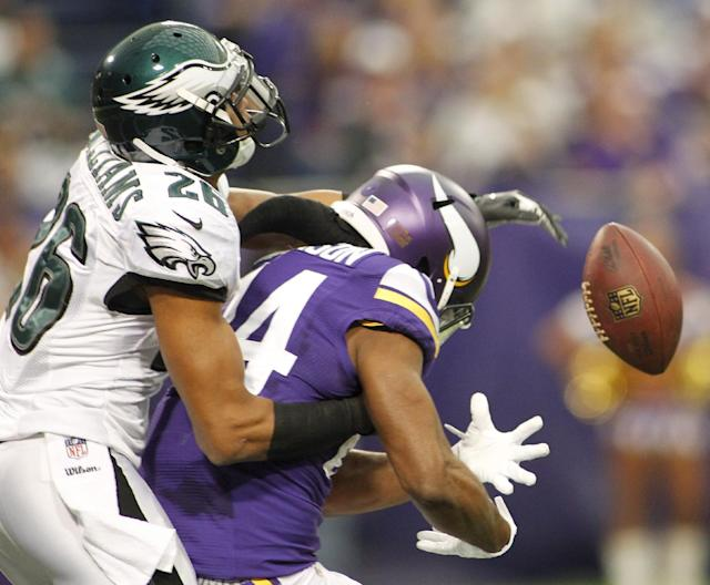 Philadelphia Eagles cornerback Cary Williams, left, breaks up a pass intended for Minnesota Vikings wide receiver Cordarrelle Patterson during the first half of an NFL football game on Sunday, Dec. 15, 2013, in Minneapolis. (AP Photo/Andy King)