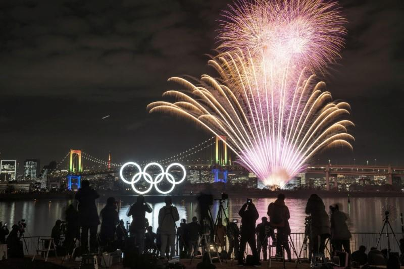 Fireworks, rings monument light up Tokyo six months before Games