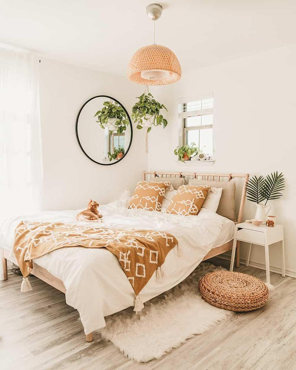 "<p>Greenery — real or faux — breathes life into any space, especially when everything else is fairly neutral. </p><p><em><a href=""https://www.atasteofkoko.com/koko-at-home/ikea-bedroom"" rel=""nofollow noopener"" target=""_blank"" data-ylk=""slk:See more at A Taste of Koko »"" class=""link rapid-noclick-resp"">See more at A Taste of Koko »</a></em></p>"