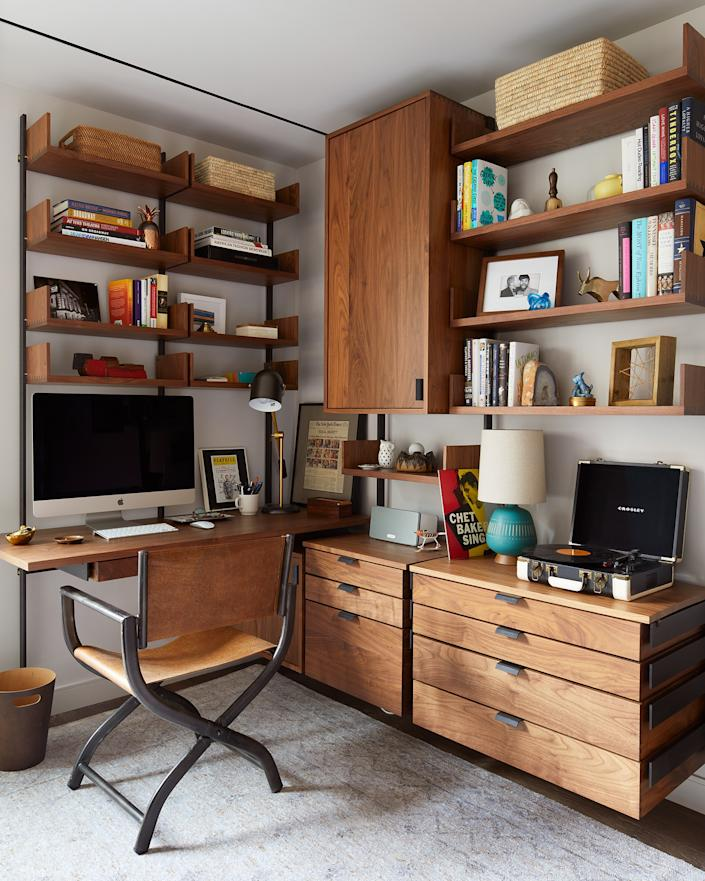 "<div class=""caption""> The home office is actually in a corner of the guest bedroom. ""I had a very specific idea of what I wanted in that desk area,"" Ferguson says. ""It took a little while to find it, but once we did, it was exactly what I pictured."" The cabinetry was done by Atlas, the chair is from <a href=""https://www.restorationhardware.com/"" rel=""nofollow noopener"" target=""_blank"" data-ylk=""slk:RH"" class=""link rapid-noclick-resp"">RH</a>, and the rug is <a href=""http://www.abchome.com/"" rel=""nofollow noopener"" target=""_blank"" data-ylk=""slk:ABC Carpet & Home"" class=""link rapid-noclick-resp"">ABC Carpet & Home</a>. </div>"