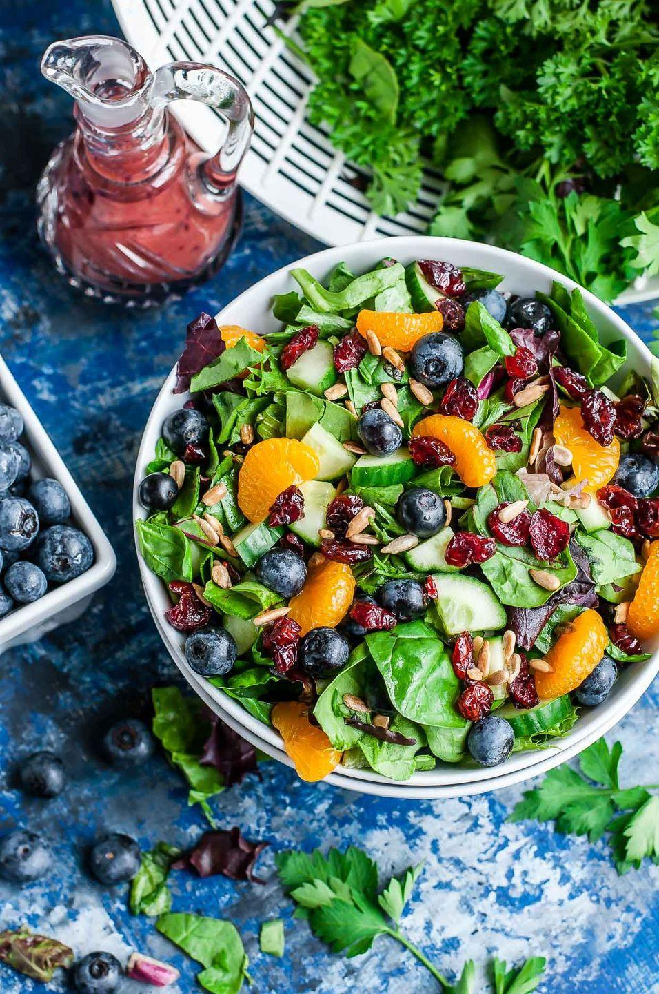 """<p>Send everyone's sweet cravings into overdrive with this summer side salad, which features a blueberry balsamic dressing as an added fruity enhancement. </p><p><strong>Get the recipe at <a href=""""https://peasandcrayons.com/2017/05/cranberry-blueberry-spring-mix-salad.html"""" rel=""""nofollow noopener"""" target=""""_blank"""" data-ylk=""""slk:Peas and Crayons"""" class=""""link rapid-noclick-resp"""">Peas and Crayons</a>. </strong> </p>"""