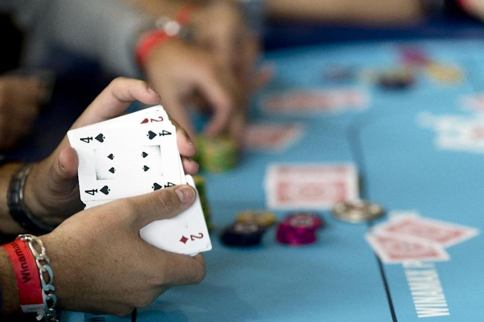 Match poker differs from the traditional game because it is played on digital devices to reduce the element of luck caused by the random dealing of cards (AFP Photo/KENZO TRIBOUILLARD)